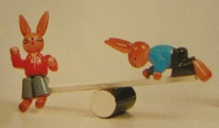Rabbits on Teeter Totter