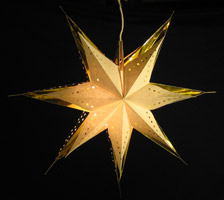 A traditional German Christmas Ornament made from folded and cut papers