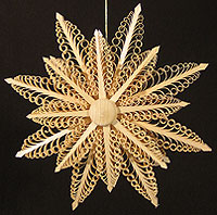 A traditional shaved polished wood ornament from Germany